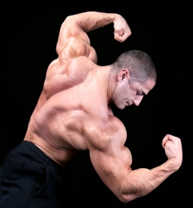 Image of: bodybuilder flexing after taking testosterone bodybuilding supplements.