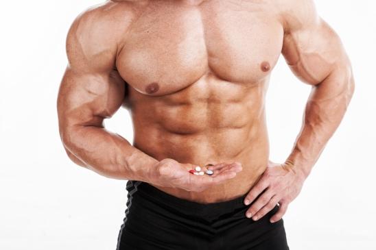 bodybuilder with pills